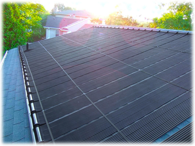 A sample installation of the Enersol solar pool panels on a sloped asphalt roof